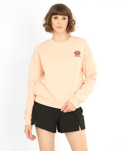 Sweater met borduursels bleekroze