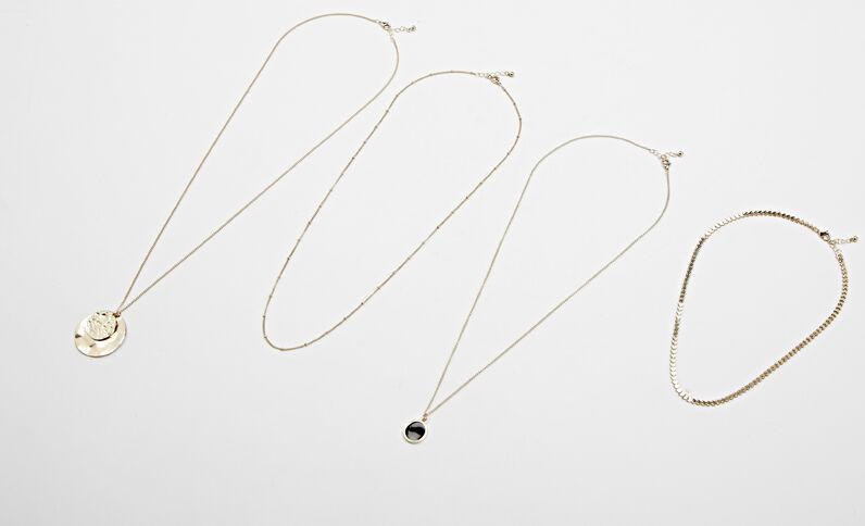 Set van 4 halskettingen goudkleurig