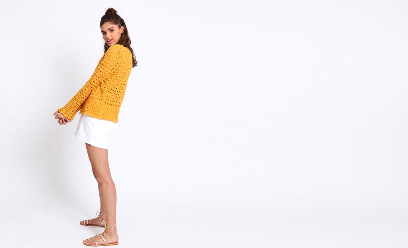 Pull en maille ajourée jaune