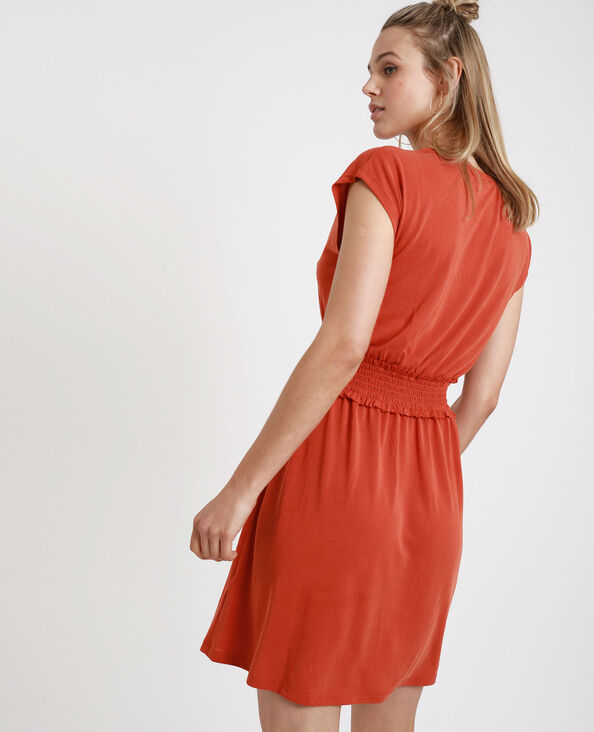 Halflange jurk met smokwerk oranje